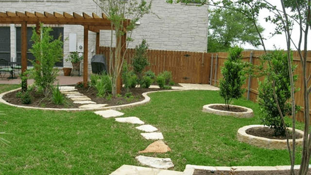 Half sodded yard with a patio
