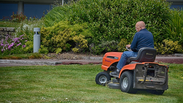 man on a riding mower